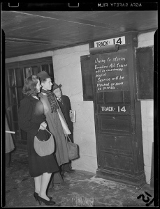 Boston commuters learn of significant train travel delays during the Valentine's Day snowstorm in 1940.  (Via Boston Public Library, Flickr)