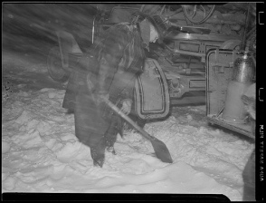 A fireman digs out his fire truck in the 1940 Valentine's Day storm.  (via Boston Public Library Flickr)