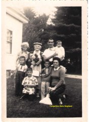 This photograph shows my great-grandmother's sister Olivia (far left, in rear) with her two grandsons in front of her.  My great-grandmother, Augusta, next to her, in rear, appears with her youngest son William, wife Bernadette, and their two children, 1958.