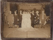 This photograph, dating from about 1940, shows Augusta (the older woman on the right) and her sister Olivia (the older woman on the left) on the day that two of their sons married their brides.